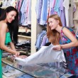 Girl seller helps shoppers — Stock Photo #6993758