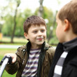 Boy on a bicycle in the green park — Stock Photo #6993802