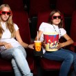 Two young girls watching in cinema — Stock Photo #6993901