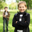 Boy with a friend in the green park — Stock Photo #6994098