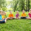 Group of children sitting together in the park — Stock Photo #7021177