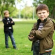 Royalty-Free Stock Photo: Boy with a friend in the green park