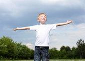 Litlle boy outdoors — Stock Photo