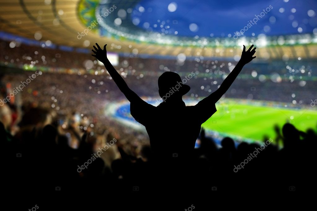 Image of a full stadium with silhouettes of fan on the foreground — Stock Photo #7020377