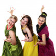 Stock Photo: Three young womin bright colour dresses