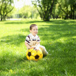 Royalty-Free Stock Photo: Little boy in the park playing with a ball