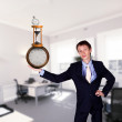 Businessman in office holding clock pyramid — Stockfoto