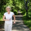 Stock Photo: Elderly woman likes to run in the park