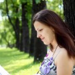 Portrait of young woman in the park — Stock Photo