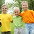 Three boys in the park — Stock Photo