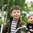 Boy on a bicycle in the green park — Stock Photo #7206334