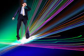 Businessman walking over Internet lines — Stock Photo