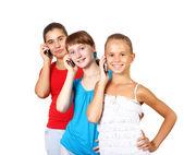 Ganska tonårsflickor med mobiltelefon — Stockfoto