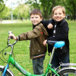 Boy on a bicycle in the green park — Stock Photo #7225901