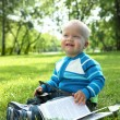 Portrait of little baby boy in the park - Stock Photo