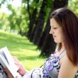 Portrait of pregnant woman in the park - Stock fotografie