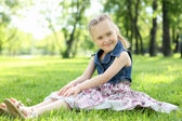 Portrait of a little girl in the park — Stock Photo