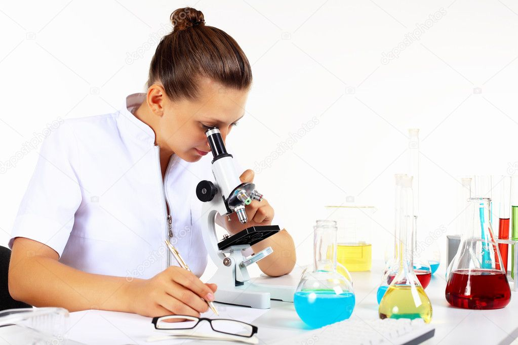 Young female scientist in a chemistry laboratory — Stock Photo #7226035