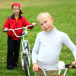 Boy on a bicycle in the green park — Stock Photo #7270353