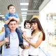 Stock Photo: Young family doing shopping