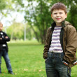 Boy with a friend in the green park — Stock Photo