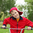 Boy on a bicycle in the green park — Stock Photo #7270377