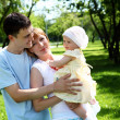 Young family together in the park — Stock Photo #7270407