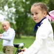 Girl on a bicycle in the green park — Stock Photo #7270630