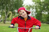 Boy on a bicycle in the green park — Stockfoto