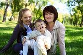 Family in summer park — Stock Photo