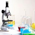 Chemistry laboratory equipment and glass tubes — Stock Photo #7354414