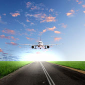 Airplane in blue cloudy sky — Stock Photo