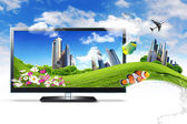 Large flat screen with nature images — 图库照片