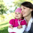 Mother with her daughter in summer park — Stock Photo