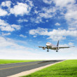 Airplane in blue cloudy sky — Stock Photo #7461610
