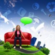 Young woman sitting on sofa nature background — Stock Photo #7519721