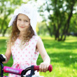 Stock Photo: Little girl in summer park