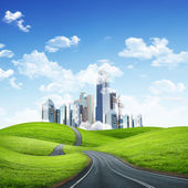 Modern city surrounded by nature landscape — Stock Photo