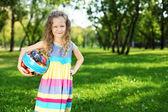 Little girl in summer park — Stock Photo