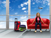 Young woman sitting on sofa in the airport — Stock Photo