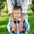 Young mother with her son in summer park — Stock Photo #7560910