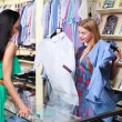 Girl seller helps shoppers — Stock Photo #7613725