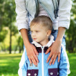 Young mother with her son in summer park — Stock Photo #7613991