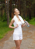 Young woman doing sport outdoors — Stock Photo