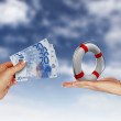Royalty-Free Stock Photo: Human hands holding money against blue sky