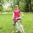 Girl with a bike in the park - Stockfoto