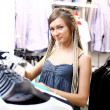 Young girl buying clothes — Foto de Stock