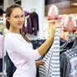 Shopping in clothes store — Stock Photo #7738719