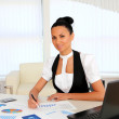 Young business woman with papers — Stock Photo #7739133