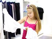 Little girl doing shopping — Stock Photo